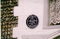 The plaque on the house