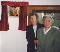 Picture of Ms. Floss Bayly with her niece in front of the plaque