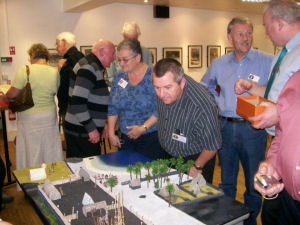Members viewing the model village
