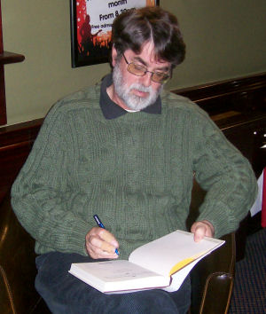 John Robson signing one of his books